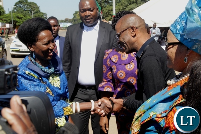 Vice President Inonge Wina is welcomed by Deputy Secretary to Cabinet Patrick Mvunga  on arrival at the freedom statue for the international women's day commemoration .looking on (center) is Lusaka Province Minister Bowman Lusambo