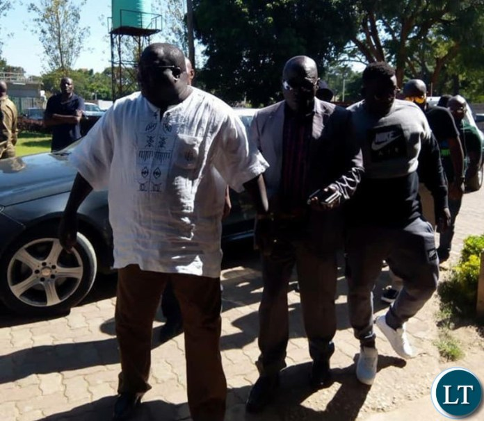Mwanba accompanied by his father Chishimba Kambwili and his lawyer Christopher Mundia and other NDC officials.