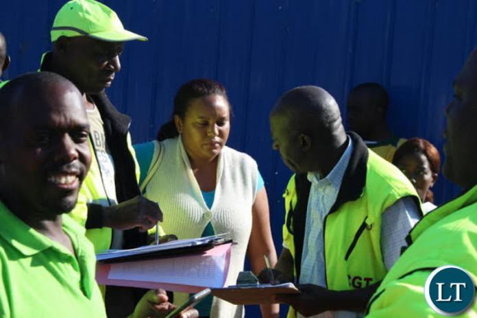 Works and Supply Minister Felix Mutati with Ministry Officials on the Street