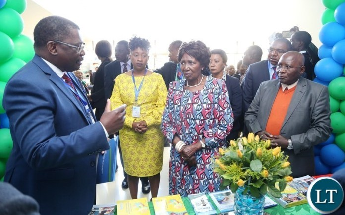 Director National Water Supply and Sanitation Council Kelvin Chitumbo stress a point to  Vice President Inonge Wina during the tour of stands shortly after the official opening of  Zambia Water Forum and Exhibition at Government Complex yesterday 11-06-2018. Picture by ROYD SIBAJENE/ZANIS
