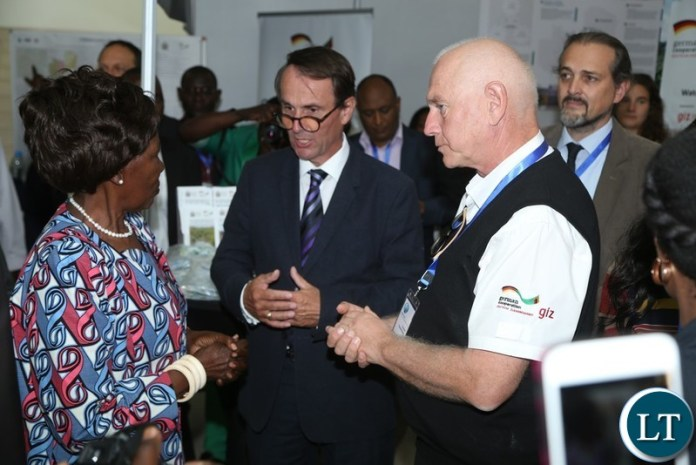 Vice President Inonge Wina confers with Corad Thombansen whilst Germany Ambassador Achim Burkart listens during the tour of stands shortly after the official opening of Zambia Water Forum and Exhibition at Government Complex yesterday 11-06-2018. Picture by ROYD SIBAJENE/ZANIS