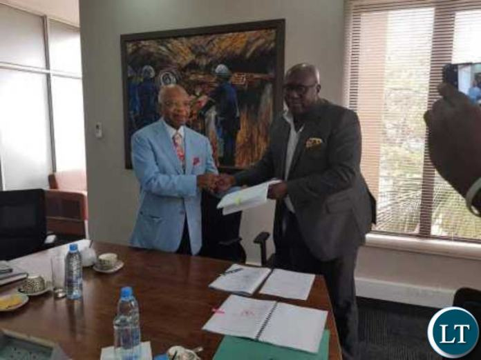 ZCCM IH CEO Pius Kasolo signs with a representative from Oranto Petroleum.