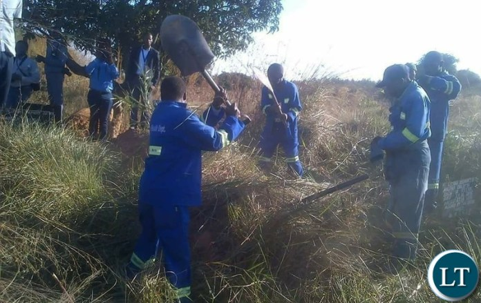 Council Workers exhuming the body of the girl who died and was buried at grave 73