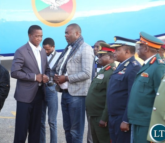 President Edgar Lungu being welcomed by Lusaka Province Minister Bowman Lusambo shortly after his arrival from Chipata at Lusaka City airport