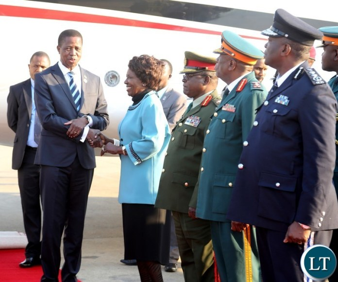 Vice President Inonge Wina welcomes President Edgar Lungu shortly after his arrival from South Africa at Kenneth Kaunda International Airport