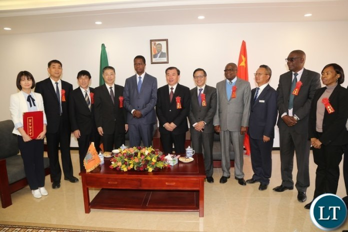 President Edgar Lungu pose for a group photograph with Sinoma members before the official opening of the China National Building Material Zambia Industry Plant in Chongwe District