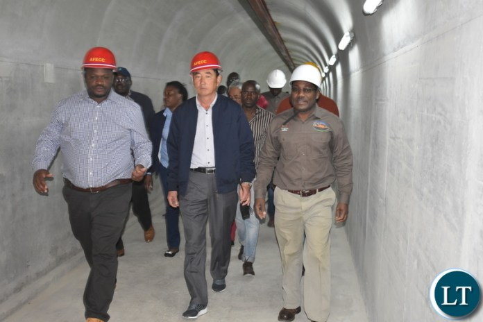 Minister of National Development Planning Hon. Alexander Chiteme (left), AFECC Contract Manager Jia Tao Kan and Ministry of Agriculture's Irrigation Development Support Project (IDSP) national project coordinator Dr Barnabas Mulenga inspecting the Mwomboshi Dam in Chibombo District on Thursday 2 August 2018. Photo | Chibaula D. Silwamba | MNDP