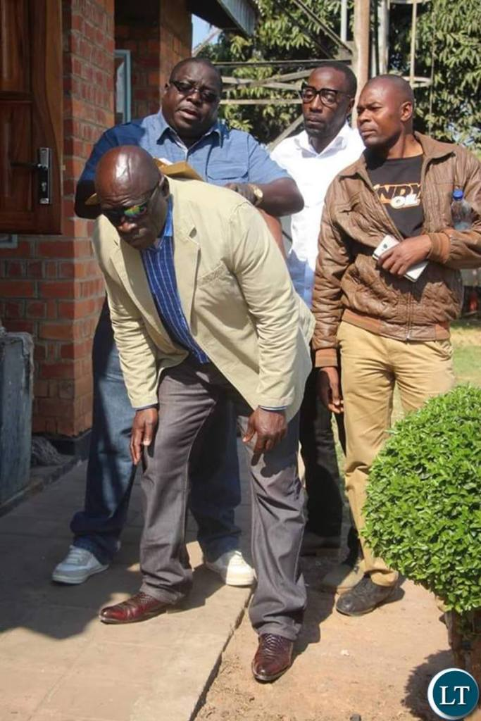 Mr Kambwili's security personnel assisting him as he prepares to file a complaint to the DEC on Tuesday