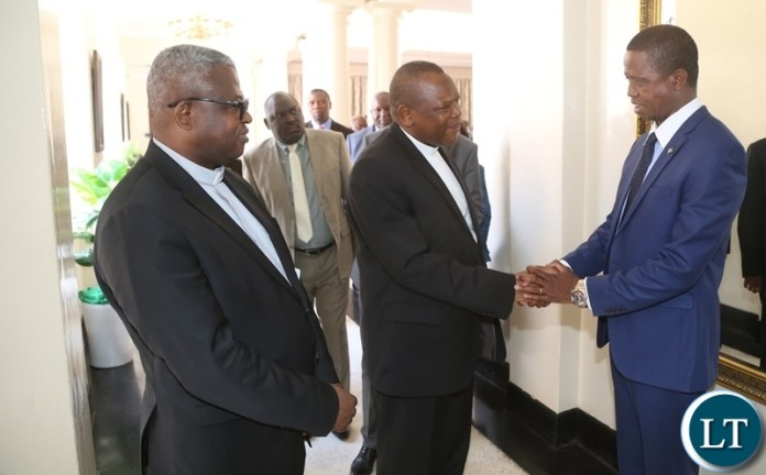 President Edgar Lungu shake hands with Vice Chair of the Conference of Catholic Bishops of Democratic Republic of Congo Bishop Fridolin Ambongo whilst Secretary General of the Conference of Catholic Bishops of Democratic Republic of Congo Bishop Donatien Nshole shortly meeting the President at State House