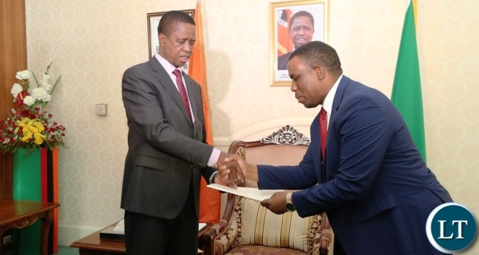 President Edgar Lungu recieves a report from Honourable Highvie Hamududu Special Advisor to the Presidency The SADC Election Observation Mission