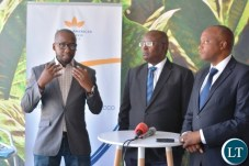 Head of legal,Mdu Lokotfwako(left) stressing a point during the media briefing on manufacturing factory company which has invested over $ 25 million in construction at the Multi Facility Economic Zone in Lusaka.Looking on is Head of operations,Jerry Chivambo(m). Director British American Tobacco,Godfrey Machanzi(r)