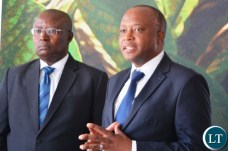 Director of British American Tobacco,Godfrey Machanzi(r) addressing the media during the tour of cigarette manufacturing factory company which has invested over $ 25 million in construction at the Multi Facility Economic Zone in Lusaka.Looking on is Head of operations,Jerry Chivambo.