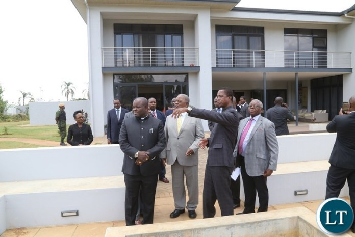 President Edgar Lungu and the 4th Republican President Rupiah Banda inspecting the House before official handover during the handover ceremony at Bonaventure