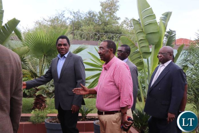HH and GBM arriving at Dr Kambwili's residence for the joint news briefing