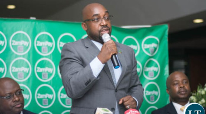Transport and Communications Minister Brian Mushimba speaking during the launch of ZamPay