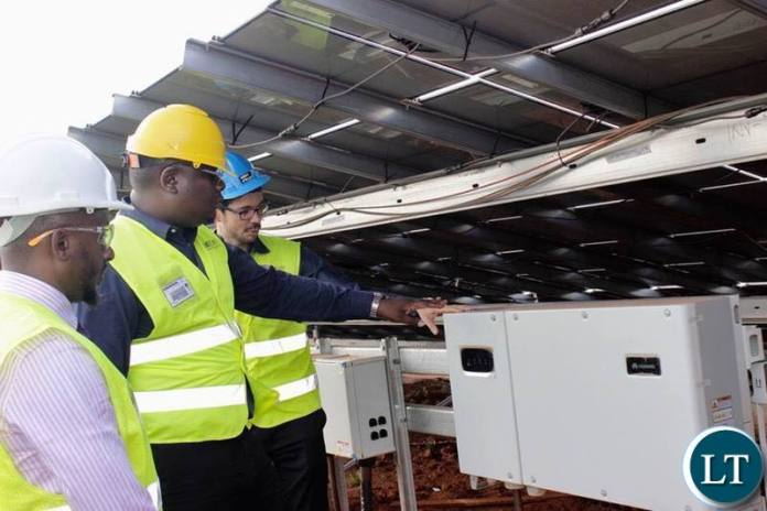 IDC Group CEO Mr Mateyo Kaluba inspecting the Solar Energy Plant