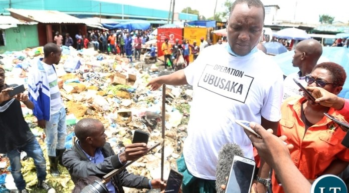 Lusaka Mayor Miles Sampa showing journalists the uncollected waste and blame his offices for not collecting the waste when they are given everything needed to keep the waste out off Central Business District