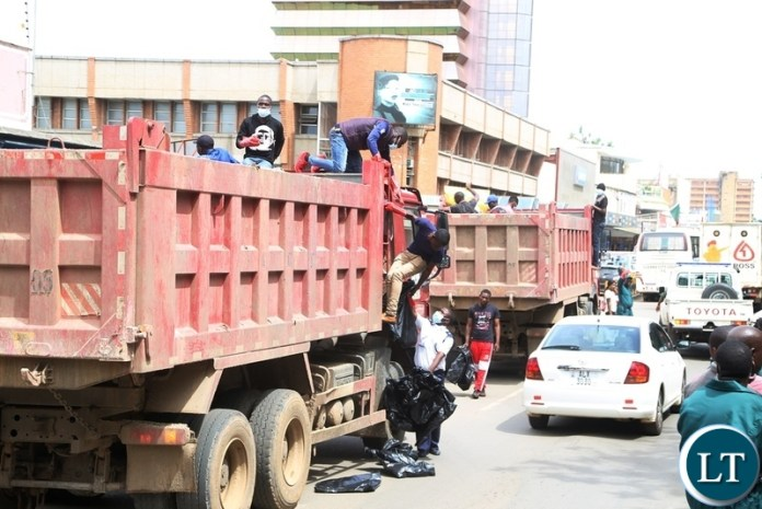 Lusaka City Council Police and others Staffs collecting waste during the Cleaning of the Central Business District