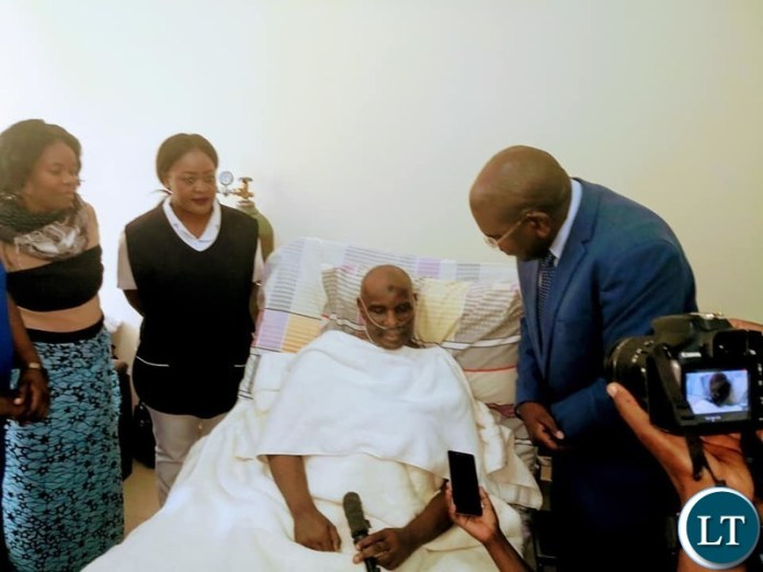 Health Minister Chitalu Chilufya visiting Former Vice President Lupando Mwape on his hospital bed at UTH