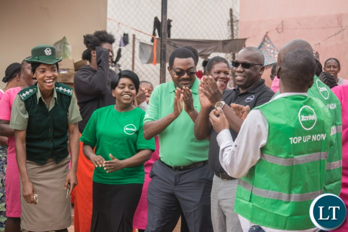 Lusaka Central Female Correctional Facility Deputy Officer in Charge Mary Filinga with the Zamtel team during the hand over of sanitary towels and bath soap for inmates