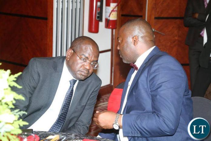 Lusaka Province Minister Bowman Lusambo chats with Health Minister Dr Chitalu Chilufya