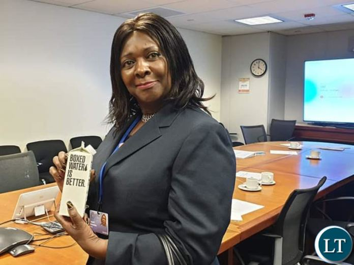 Finance Minister Margaret Mwanakatwe shows off a boxed water after a meeting with the World Bank in Washington D.C