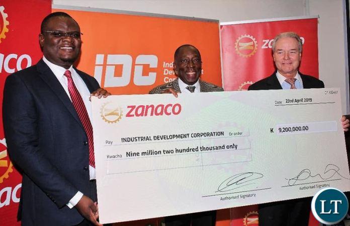 IDC Group CEO Mr Mateyo Kaluba (left), ZANACO Board Vice Chairperson Mr Hastings Mtine and ZANACO CEO Mr Henk Mulder (right) showing the dividend cheque.
