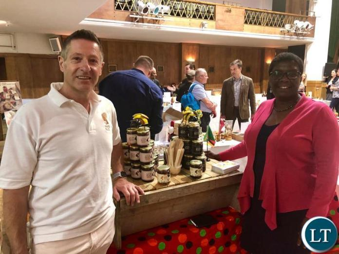 Mama Buci founder Martin Zuch with First Secretary Trade Mrs Irene Chengo Mudenda at the World Bee Day in London