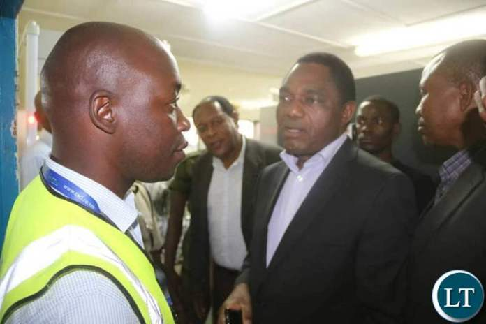 HH talks with an official from the Airports Corporation at the Simon Mwansa Kapwepwe airport