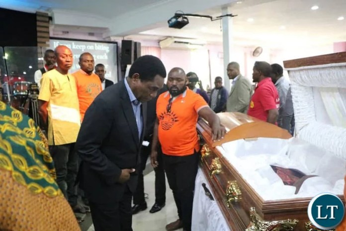 HH views the body of late Mr Kasongo during Church service at Northmead Assemblies of God