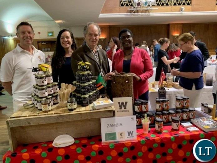 Martin Zuch with Ian Wainwright and his daughter, (far end) First Secretary Trade Mrs. Irene Chengo Mudenda at the World Bee Day in London