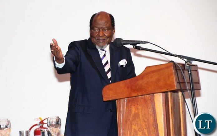 Chairperson of the Africa Forum and former Mozambican President Joaquim Chissano delivering his speech and a message to KK.