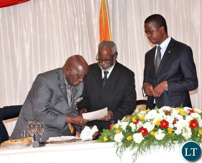 Namibia former president Sam Nujoma delivering a message to KK while president Edgar Lungu is looking on.
