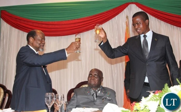 President Edgar Lungu proposing a toast to Chairperson of the Africa Forum and former Mozambican President Joaquim Chissano  while KK is looking on.
