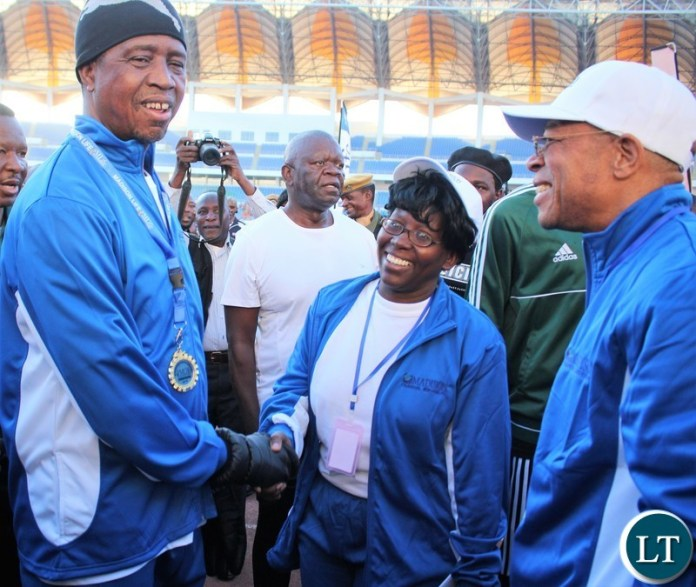 President Edgar Lungu on 2019 ICR 10 km race finishing line and being awarded a participation medal and congratulated by Madison Life board chairman Lawrence Sikuntwa and Madison Life CEO Agnes Chakonta at Lusaka National Heroes Stadium