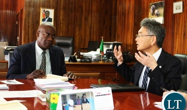 Japanese Ambassador to Zambia HIDENOBU SOBASHIMA with Finance Minister Bwalya Ng'andu at the Ministry of Finance headquarters in Lusaka