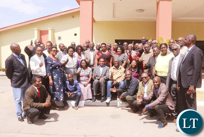 Members of the UPND National Management Committee posing for a photo with HH