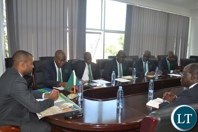 Housing and Infrastructure Minister Vincent Mwale with officials from the Engineering Institution of Zambia after they paid a courtesy call at his office