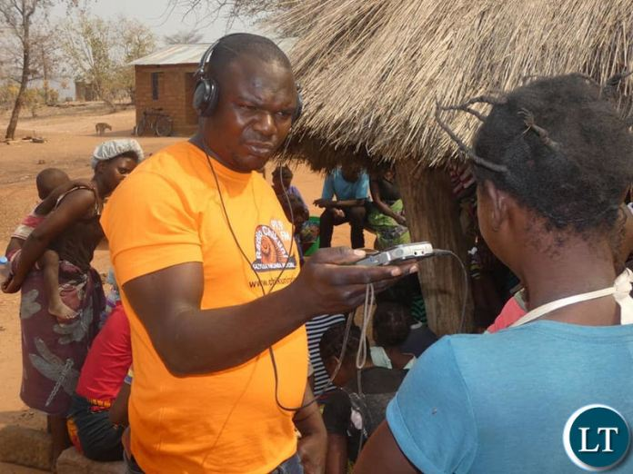 A Journalist from Chikuni Radio interviewing villagers in Pemba on the extent of the drought