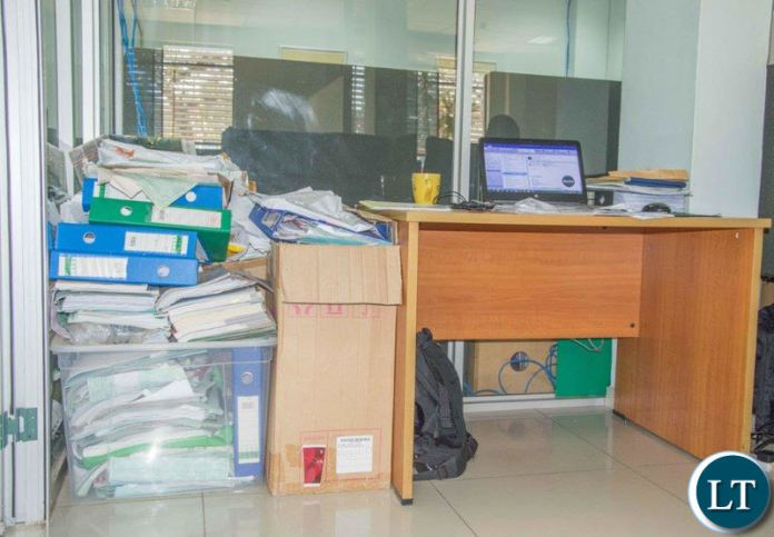 BEFORE PICTURE: Piles of office cluster in one of the Zamtel offices before the clean up.