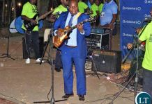 Southern Province Minister Edify Hamukale strings a guitar with his Band during the ongoing Southern Province Tourism and Investment Expo