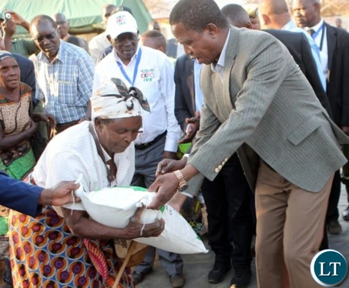President Lungu donating a Mealie Meal bag to a draught victims in Southern Province