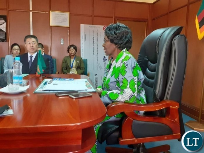 Vice President Inonge Wina Receiving a K1 Million Cheque from China Jiangxi International Economic and Technical Cooperation Limited towards the hunger mitigation in some parts of the country.