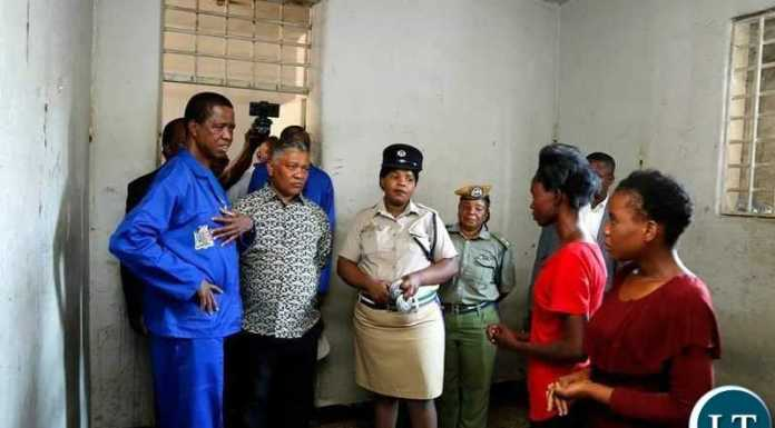PRESIDENT Edgar Chagwa Lungu (second from left) visits detainees in cells at Kabwata Police in Lusaka on Saturday,October 26,2019.