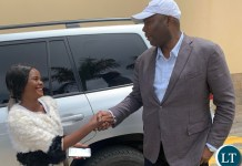 Lusaka Province Minister Bowman Lusambo poses for a photo with Tina Kaluza after She was gifted with a K5,000