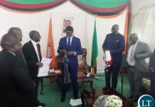 President Lungu receiving a ZANACO Jersey Replica