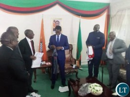 President Lungu receiving a ZANACO Jersey Replica