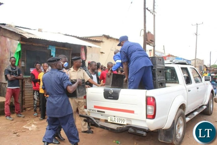 Police arrest people violating President Edgar Chagwa Lungu's directive to the Nation to have all bars closed amongst other directives in order to curb the outbreak of the Corona Virus in Zambia.