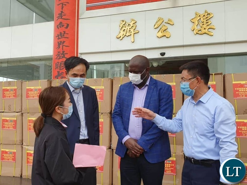 Consul General at the Consulate of the Republic of Zambia in Guangzhou His Excellency Mr. Daniel Chisenga Receiving  the Donations