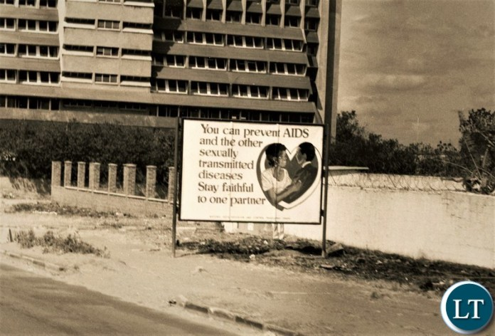 AIDS Black and White – A sign about HIV/AIDS prevention on the Great North near the North-End of Cairo Road in Lusaka in 1993.